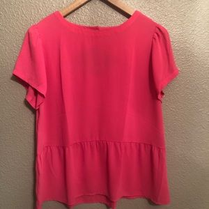 pink peplum top with a cute back.